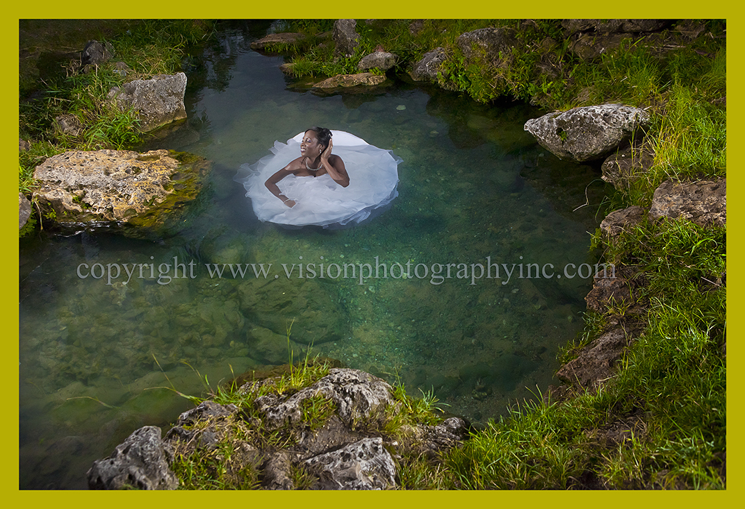 A wedding dress turns into a water lily at a trash the dress session